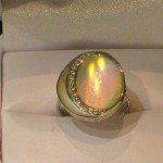 14K white gold ring with large Rainbow moonstone and Diamonds.
